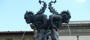 Sea creature detail of the bronze fountain in the Piazza della Santissima Annunziata, Florence, Italy
