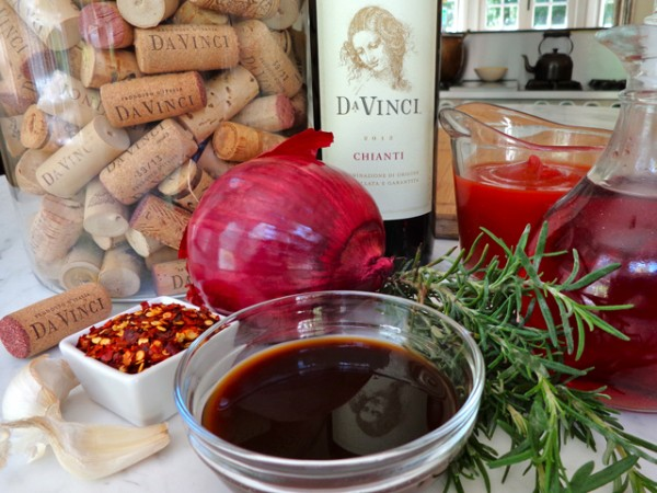 "DaVinci's Chianti is the prefect base to build a BBQ sauce—a dark and complex ""sweet"" with its aromas of ripe fruit and flavors of strawberry and plum. Strained tomatoes, brown sugar, and red onion round out the ""sweet."" For the ""bite"": red wine vinegar, Worcestershire sauce, and lemon. The ""spice"": red pepper flakes and garlic. Plus, I added rosemary for its earthy flavor to accentuate the ""smoke and char of the grill"" and the darker fruit flavors of the wine."