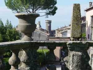 Day 8 Photo- looking over a railing at Villa Lante toward the clock tower in Bagnaia.