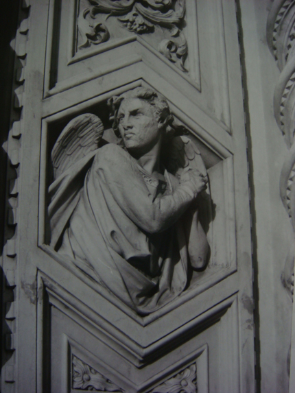 Prologue- Angel on the facade of the Duomo, Firenze, Italia.